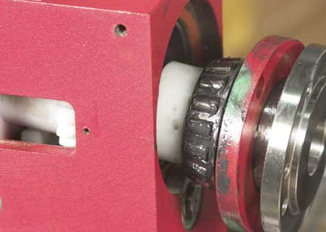 Grease front bearing and insert spindle