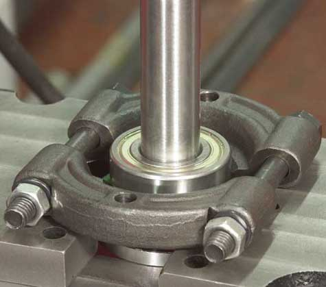 Extract the front bearing using a press or mallet
